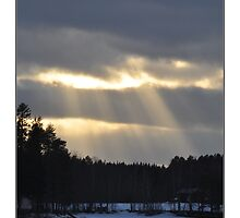 sun's rays on the April sky by Maj-Britt Simble