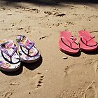 Thongs on a beach by Adelheid