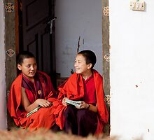 Two nuns chatting in a classroom doorway by cpcphoto