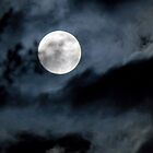 full moon in a cloudy sky by piwaki