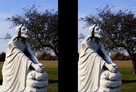 WOMAN KNEELING AT THE CROSS