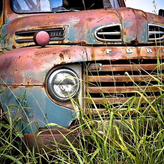 Old, beat up, rusty Ford truck