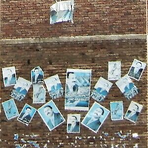 Posters neatly arranged on a wall in Sana'a